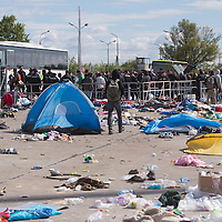 Illegal migrants traveling to Germany get on a bus at Hegyeshalom border crossing (about 180 km West of capital city Budapest), Hungary on September 06, 2015. ATTILA VOLGYI
