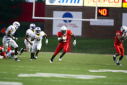 10 September 2011: Ashton Leggett cuts up the middle on a running play during an NCAA football game between the Morehead State Eagles and the Illinois State Redbirds at Hancock Stadium in Normal Illinois.