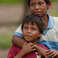 Yanayacu Indian brothers study visitors to Ayacucho de Tipisha village in Peru's Amazon Jungle.