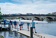 Henley-On-Thames, Berkshire, UK., Thursday,  03/06/2021,  Cambridge University crew athletes, carry their boat off the Leander Club pontoon after on training outing on Henley Reach,[ Mandatory Credit © Peter Spurrier/Intersport Images],