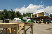 Crews work on the VIP area for Laconia Fest with the main stage to be constructed later this week as set up begins for Laconia Fest at the Weirs Beach Drive In for Motorcycle Week 2016.  (Karen Bobotas/for the Laconia Daily Sun)