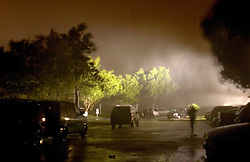 24 Sept, 2005.  Beaumont, Texas. Hurricane Rita <br /> <br /> Running for cover at the parking lot of the Hotel Elegante in Beaumont as Hurricane Rita roars in in the early hours of Saturday morning.<br /> Photo; ©Charlie Varley/varleypix.com