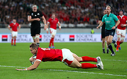 Wales' Hallam Amos scores his sides first try during the 2019 Rugby World Cup bronze final match at Tokyo Stadium.