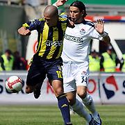 Kasimpasaspor's Emre TORAMAN (R) and Fenerbahce's Alexsandro de SOUZA (L) during their Turkish superleague soccer match Kasimpasaspor between Fenerbahce at the Recep Tayyip Erdogan stadium in Istanbul Turkey on Sunday 25 April 2010. Photo by TURKPIX