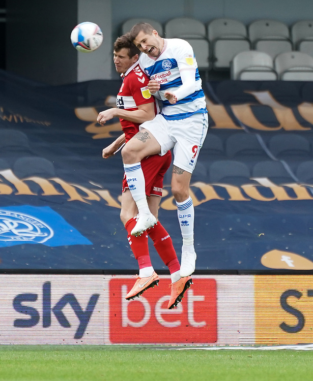 Queens Park Rangers' Lyndon Dykes battles for possession with Middlesbrough's Paddy McNair<br /> <br /> Photographer Stephanie Meek/CameraSport<br /> <br /> The EFL Sky Bet Championship - Queens Park Rangers v Middlesbrough - Saturday 26th September 2020 - Loftus Road - London <br /> <br /> World Copyright © 2020 CameraSport. All rights reserved. 43 Linden Ave. Countesthorpe. Leicester. England. LE8 5PG - Tel: +44 (0) 116 277 4147 - admin@camerasport.com - www.camerasport.com