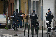 Nov. 16, 2015 - Brussels, BELGIUM - <br /> BRUSSELS, BELGIUM:<br /> <br /> Search for Paris Terror Suspect in Brussels<br /> <br /> Illustration picture shows policemen in the neighborhood of searchings at a house in the Delaunoystraat - Rue Delaunoy in Sint-Jans-Molenbeek / Molenbeek-Saint-Jean, Brussels on Monday 16 November 2015. During the weekend searches were carried out and multiple people were arrested in relation to Friday's terrorist attacks in Paris. Several terrorist attacks in Paris, France, have left at least 129 dead and 350 injured. Most people were killed during a concert in venue Bataclan, the other targets were a restaurant and a soccer game. The attacks have been claimed by Islamic State.<br /> ©Exclusivepix Media