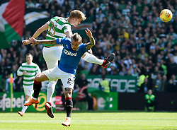 Celtic's Krisoffer Ajer heads clear from Rangers' Jason Cummings during the Ladbrokes Scottish Premiership match at Celtic Park, Glasgow.