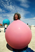 A man from Argentina who gets inside a balloon to entertain people at Burning Man. Burning Man is a performance art festival known for art, drugs and sex. It takes place annually in the Black Rock Desert near Gerlach, Nevada, USA.