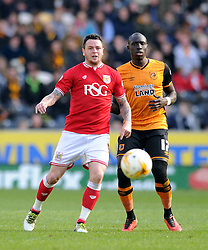 Lee Tomlin of Bristol City passes the ball under pressure from Mohamed Diame of Hull City - Mandatory by-line: Dougie Allward/JMP - 02/04/2016 - FOOTBALL - KC Stadium - Hull, England - Hull City v Bristol City - Sky Bet Championship