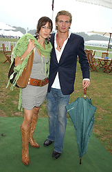 PRINCESS TAMARA CZARTORYSKI-BOURBON and JACOBI ANSTRUTHER-GOUGH-CALTHORPE at the 2005 Cartier International Polo between England & Australia held at Guards Polo Club, Smith's Lawn, Windsor Great Park, Berkshire on 24th July 2005.<br /><br />NON EXCLUSIVE - WORLD RIGHTS