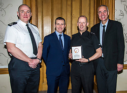Pictured: Assistant Chief Constable John Hawkins, Michael Matheson, Inspector Greig Rankine, National Volunteer co-ordinator<br /> Today the Police Scotland's Youth Volunteer scheme was presented with 'Investing in Volunteers' award by Volunteer Scotland. Assistant Chief Constable John Hawkins, Justice Secretary Michael Matheson, and George Thomson (Chief Executive) from Volunteer Scotland were on hand for the ceremony.<br /> <br /> <br /> Ger Harley | EEm 13 December 2017