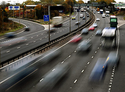 Embargoed to 0001 Monday June 26 File photo dated 26/10/09 of traffic on a motorway, as urgent action is needed to tackle both greenhouse gases and air pollution from road transport - but it could leave a multibillion-pound hole in annual tax receipts, a report warns.