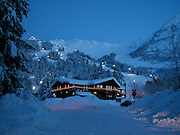 The Jade Shop in at the base of Mt Alyeska Ski Resort in Girdwood Alaska decorated with holiday lights for the snowy winter