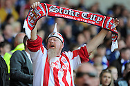 a Stoke city fan shows his support. Barclays Premier league match, Cardiff city  v Stoke city at the Cardiff city stadium in Cardiff, South Wales on Saturday 19th April 2014. pic by Andrew Orchard, Andrew Orchard sports photography,