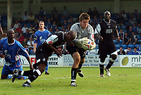 Photo: Olly Greenwood.<br /> Gillingham v Swansea City. Coca Cola League 1. 16/09/2006. Swansea's Leon Knight tries to get to the ball before Gillingham's Scott Flinders