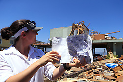 Elise Moore holds up a diary her in-laws kept detailing experiences when guests would visit their vacation home in Copano Cove in Rockport, Texas, USA, on Wednesday, August 30, 2017. Photo by Rachel Denny Clow/Corpus Christi Caller-Times/TNS/ABACAPRESS.COM