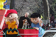 l to r: Charlie Brown, Uno, Jonn Woodring, Co-owner and Lucy and  at The Macy's 82nd Annual ThanksGiving Day Parade held in NYC on Thankgiving Day, Novemeber 27, 2008..Macy's Thanksgiving Day Parade is internationally recognized as the official start to the holiday season and world famous as an American enterainment extravaganza. Each year, Macy's brings out a lineup of spactacular floats, Giant Hellium Balloons, Marching Bands, perfomance groups and top name stars from the television, film and recording industries.