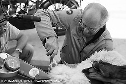 Michel Magnin of France does some repair work while on a pit stop during Stage 5 of the Motorcycle Cannonball Cross-Country Endurance Run, which on this day ran from Clarksville, TN to Cape Girardeau, MO., USA. Tuesday, September 9, 2014.  Photography ©2014 Michael Lichter.
