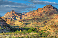 """The Chisos Mountains of West Texas is the southernmost mountain range in the United States, and is surrounded by the Chihuahuan Desert on the US-Mexico border. Located wholly within the borders of Big Bend National Park, this incredible view of this ancient volcanic mountain range was photographed on a late spring afternoon as the sun began to set in the """"golden hour""""."""