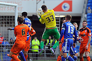 Ipswich goalkeeper Bartosz Bialkowski (33) claims a catch under pressure from a corner. Skybet football league championship match, Cardiff city v Ipswich Town at the Cardiff city stadium in Cardiff, South Wales on Saturday 12th March 2016.<br /> pic by Carl Robertson, Andrew Orchard sports photography.