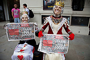 "The last ever copies of tabliod newspaper News of The World being held by two street performers dressed like Queen Elizabeth II. Sunday 10th July 2011 saw the end for this most famous of newspapers. Embroiled in the phone hacking scandal, this News International paper had approximately 7 million readers at the time of it's demise. On the cover of this, the final edition, with examples of previous journalistic success the headline simply read ""Thank You & Goodbye""."