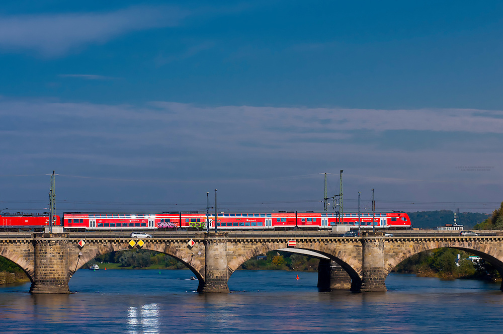 A train crossing Marienbrucke (bridge) over the Elbe River, Dresden, Saxony, Germany