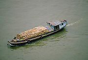 Cargo being transported in sacks in a barge along the Pearl River, Canton, China