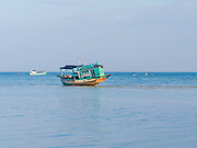 A boat is stranded at low tide off of Koh Rong Island. Photo taken from Preak Svay, Koh Rong Island, Cambodia.