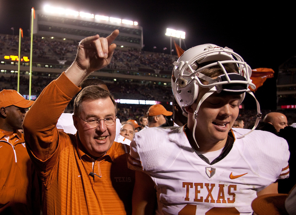 Colt McCoy, quarterback #12, with Greg Davis, offensive coordinator. Texas Longhorns at Texas A&M Aggies. Photographed at Kyle Field in College Station, Texas on Thursday, November 26 2009. Photograph © 2009 Darren Carroll