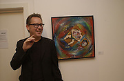 Vic Reeves in front of one of his paintings. Vic Reeves exhibition. Britart.com. 4 July 2002. © Copyright Photograph by Dafydd Jones 66 Stockwell Park Rd. London SW9 0DA Tel 020 7733 0108 www.dafjones.com