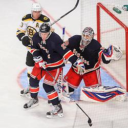 New York Rangers goalie Henrik Lundqvist (30) makes a catching glove save behind defenseman Ryan McDonagh (27) and Boston Bruins center Chris Kelly (23) during third period NHL action between the New York Rangers and the Boston Bruins at Madison Square Garden in New York, N.Y.