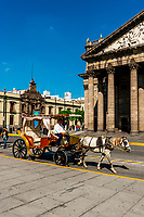 A calandria (horse drawn carriage) in front of Teatro Degollado in the Historic Center of Guadalajara, Jalisco, Mexico