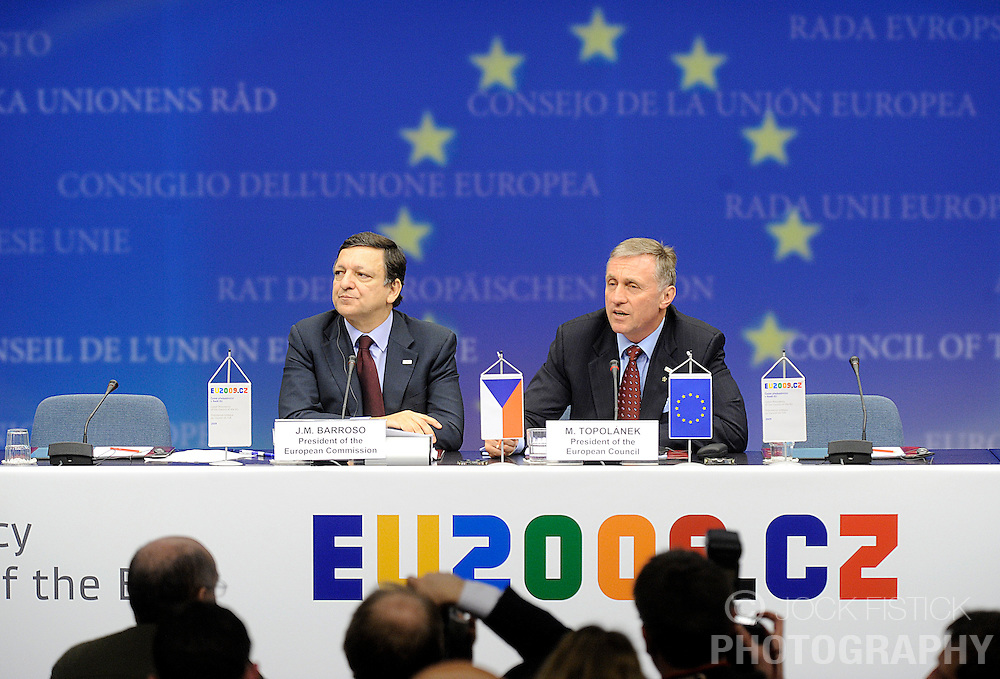 Jose Manuel, Barroso, president of the European Commission, left, listens as Mirek Topolanek, prime minister of the Czech Republic, speaks during a news conference, following the European Union summit at EU headquarters in Brussels, Belgium, on Sunday, March. 1, 2009. .(Photo © Jock Fistick)