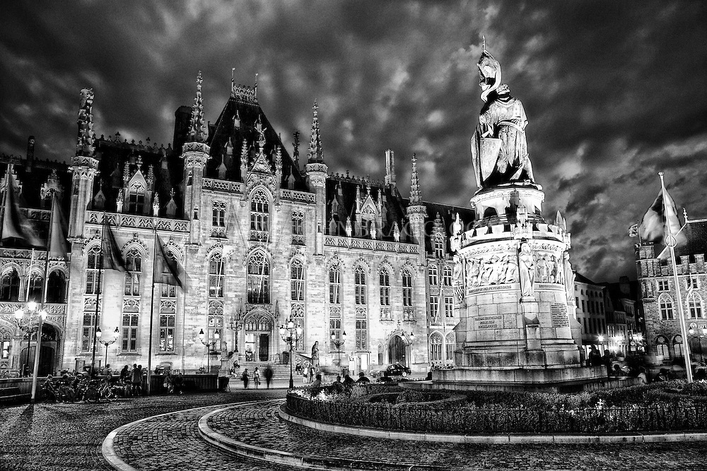 Dramatic evening shot of the Markt in Bruges, Belgium. Black and white.  B&W