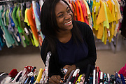 Foster child Aleta laughs with coworkers while organizing clothes at Goodwill in Milpitas, California, on September 26, 2013. (Stan Olszewski/SOSKIphoto)