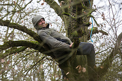 Harefield, UK. 14th January, 2020. Freeman, a Stop HS2 activist, takes refuge in a tree as enforcement agents working on behalf of HS2 Ltd attempt to evict activists from a wildlife protection camp close to Harvil Road. Part of the nearby Harvil Road camp had been evicted by bailiffs the previous week. 108 ancient woodlands are set to be destroyed by the high-speed rail link and further destruction of trees for HS2 in the Harvil Road area is believed to be imminent.