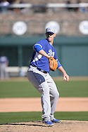 GLENDALE, AZ - MARCH 05:  Ryan Butcher #76 of the Los Angeles Dodgers pitches while wearing a Leatherhead Sports baseball glove against the Chicago White Sox at The Ballpark at Camelback Ranch in Glendale, Arizona. (Photo by Ron Vesely)