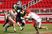 Manteca tight end Greg Jones (12) catches a pass in the end zone for a touchdown as Oakdale defensive back Tyler Flores (2) lays a hard tackle on him during Friday Night Lights at Levi's Stadium in Santa Clara, California, on October 11, 2014. (Stan Olszewski/ Special to The Record)