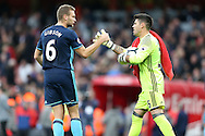 Ben Gibson of Middlesbrough congratulates Goalkeeper Victor Valdes of Middlesbrough after full time. Premier league match, Arsenal v Middlesbrough at the Emirates Stadium in London on Saturday 22nd October 2016.<br /> pic by John Patrick Fletcher, Andrew Orchard sports photography.