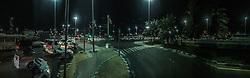 An iPhone6 night panoramic image on a road in Abu Dhabi. Images from the MSC Musica cruise to the Persian Gulf, visiting Abu Dhabi, Khor al Fakkan, Khasab, Muscat, and Dubai, traveling from 13/12/2015 to 20/12/2015.