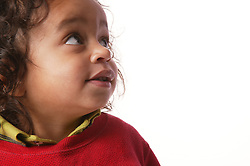 Side Portrait of a toddler gazing upwards,