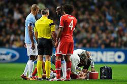 Bayern Midfielder Toni Kroos (GER) receives treatment after colliding with Man City Defender Micah Richards (ENG) during the first half of the match - Photo mandatory by-line: Rogan Thomson/JMP - Tel: Mobile: 07966 386802 - 02/10/2013 - SPORT - FOOTBALL - Etihad Stadium, Manchester - Manchester City v Bayern Munich - UEFA Champions League Group D.