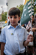 A young boy waves a Kashmiri flag during a Free Kashmir protest at Parliament Square on the 3rd September 2019 in London in the United Kingdom. Protesters gather near the statue of Mahatma Gandhi in solidarity following Indian Prime Minister Narendra Modi's Independence Day speech removing special rights of Kashmir as an autonomous region.