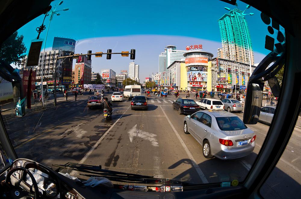 Looking down onto street scene from a bus window, Zhenjiang, China