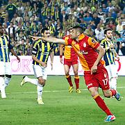 Galatasaray's Burak Yilmaz celebrate his goal during their Turkish superleague soccer derby match Fenerbahce between Galatasaray at the Sukru Saracaoglu stadium in Istanbul Turkey on Sunday 12 May 2013. Photo by Aykut AKICI/TURKPIX