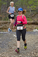 Gardiner, New York - Jill Hartley (42) competes in the Rock the Ridge 50-mile endurance challenge race at the Mohonk Preserve on May 4, 2013. The race is part of Mohonk's 50th anniversary celebration and a fundraiser for the preserve.