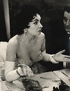Paris.1956.Gina Lollobrigida in a heated discussion during a gala night for the film Trapeze.<br /> <br /> <br /> Paris.1956.Gina Lollobrigida durant une discussion animée au cours d'une soirée de gala pour le film Trapeze.