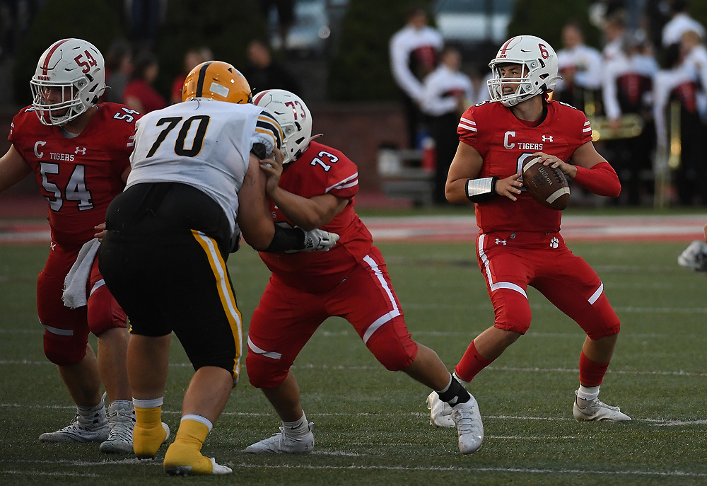 Tyler McGowan #6 of the Moon Tigers drops back to pass in the first half during the game against the Montour Spartans at Tiger Stadium on September 3, 2021 in Moon Township, Pennsylvania.