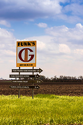 Vintage Funks G Hybrid corn seed company sign with directional arrows to help find the Funks historic sites near Shirley Illinois.