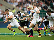 Twickenham, Surrey, United Kingdom. Jonny MAY, gets past Patriio ALBACETE [Black Scrum Cap[ and Richard HIBBARD, during the, Old Mutual Wealth Cup, England vs Barbarian's match, played at the  RFU. Twickenham Stadium, on Sunday   28/05/2017England    <br /> <br /> [Mandatory Credit Peter SPURRIER/Intersport Images]